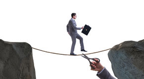 The hand cutting the rope under businessman tightrope walker Stock Images