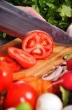 Hand cutting tomato Royalty Free Stock Photo