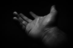Hand in the dark Royalty Free Stock Image