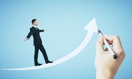 Hand dawing white arrow with businessman royalty free stock photography