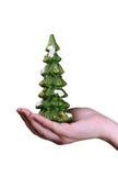 In hand de herinnering van de kerstboom Royalty-vrije Stock Afbeeldingen