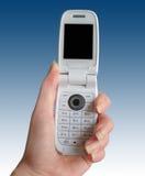 In hand de telefoon van de cel Stock Afbeelding