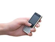 In hand de telefoon van de cel Stock Foto's