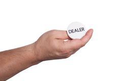 The hand with the dealer button Stock Images