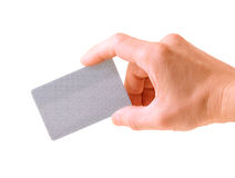 Hand with a debit card. Isolated on white Stock Image