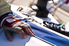 Sailor on boat in regatta, Barcolana, Italy. Close up of hand resting during boating regatta in Barcolana, Italy Royalty Free Stock Photography