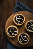 Hand decorated artisan chocolate tarts Stock Photography
