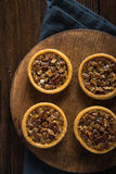 Hand decorated artisan pecan nut tarts Royalty Free Stock Photo