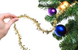Hand decorating christmas tree Royalty Free Stock Photo