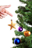 Hand decorating christmas tree with golden star Royalty Free Stock Photography