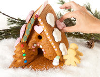 Hand decorating gingerbread house Stock Photography