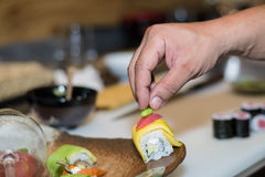 Hand decorating japanese delicacies Royalty Free Stock Photo