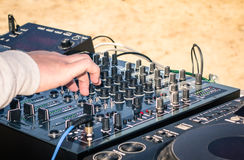 Hand of a deejay playing music on professional mixer Royalty Free Stock Photo