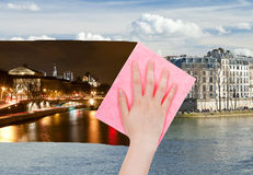 Hand deletes night view of Paris by pink cloth Stock Images