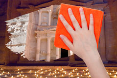 Hand deletes night view of Petra by orange rag Royalty Free Stock Images