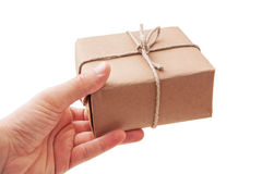 Hand deliver a parcel. On white background royalty free stock image