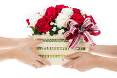 Hand delivers baskets of red and white rose flowers stock images