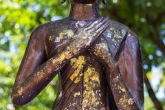 Hand der Buddha-Statue Stockfotografie