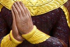 Hand der Buddha-Statue Stockfotos