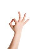Hand der Frau, die eine Geste zeigt Stockfotografie