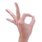 Hand der Frau Geste auf Weiß okay oder okay bildend Stockfotos