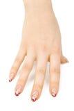 Hand der Frau mit einer netten Maniküre Stockfotografie