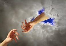 Hand der Gotthilfe Stockfotos