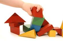 Hand der Kinder hat Aufbau zerstört Stockbilder