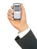 Hand des Geschäftsmannes, die einen Handy anhält Stockfotografie