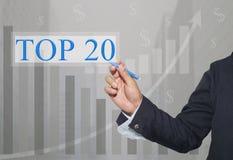 Hand des Geschäftsmannes Write ein Text von TOP20 lizenzfreies stockfoto