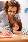 Hand des Lehrerholding-Kursteilnehmers Stockbilder
