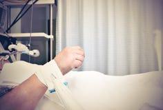 Hand des leidenden Patienten Stockfotos