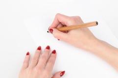Hand des Mädchens zwei mit dem Bleistift Lizenzfreies Stockbild