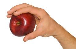 Hand des Mannes, die einen Apfel anhält stockfotos
