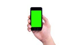 Hand des Mannes intelligentes Mobiltelefon mit Farbenreinheitsschlüssel-Grünschirm auf weißem Hintergrund halten Stockfotografie