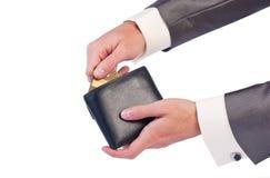 Hand des Mannes mit einem Fonds und einer Kreditkarte Lizenzfreie Stockfotografie