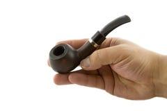 Hand des Mannes mit einem rauchenden Tabakrohr Lizenzfreies Stockbild