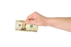 Hand des Mannes mit einer Banknote Stockfoto
