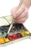 Hand des Mannes mit Malerpinsel Stockbild