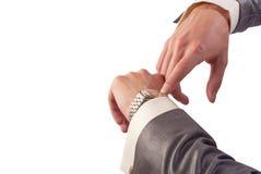 Hand des Mannes mit Uhr Stockfoto