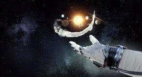 Hand des Raumfahrers Gemischte Medien Lizenzfreie Stockfotografie