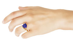 Hand with Designer Ring of Tanzanite, Diamonds and Gold Royalty Free Stock Photos