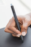 Hand of designer using stylus and digitizer Royalty Free Stock Photos