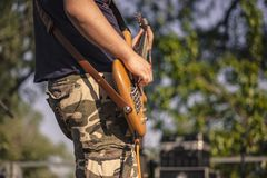 Hand detail while playing acoustic bass  3. Hand detail while playing a wooden acoustic bass at a rock concert stock photo