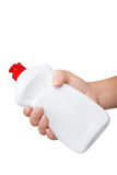 Hand with a detergent  plastic bottle isolated Stock Image