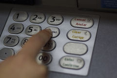 Hand dialing ATM code Stock Images