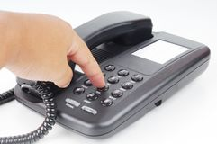 A hand dialing phone number Stock Photography