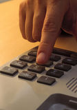 Hand dialing telephone Stock Images