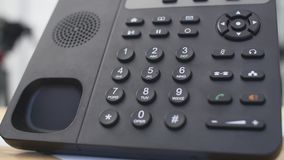 Hand dials the number on the telephone. Woman`s hand dials the number close-ups stock video