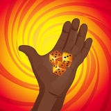 Hand with dices on yellow and red background Royalty Free Stock Images